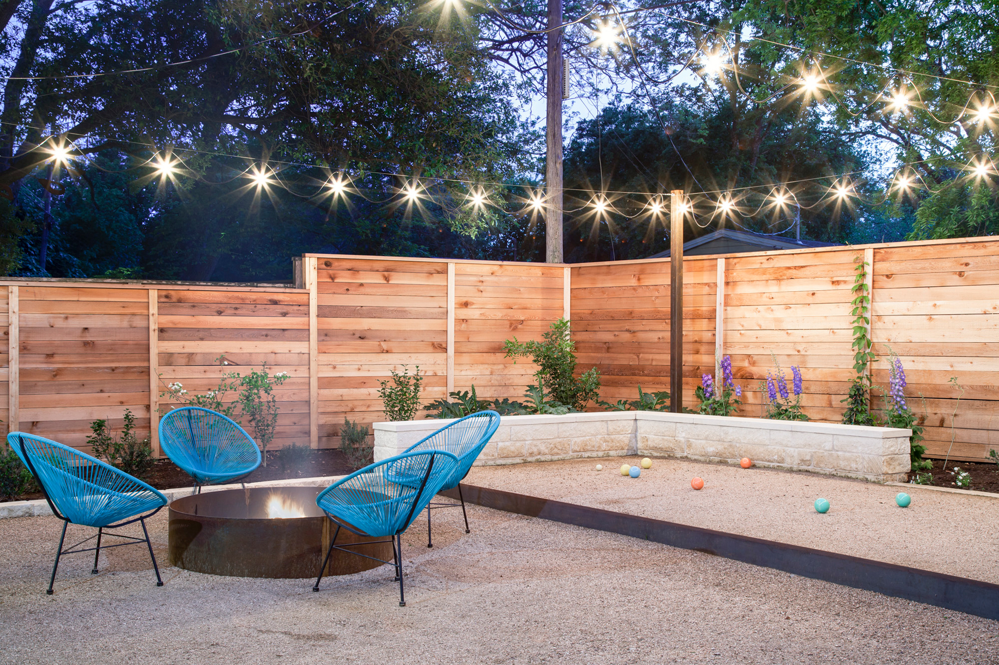 Backyard with firepit and bocce ball court