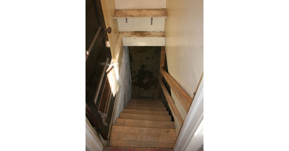 Basement stairway before renovation