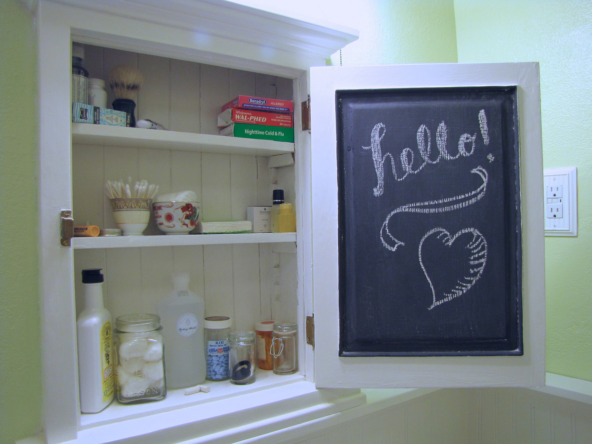 Recessed medicine cabinet with chalkboard inside