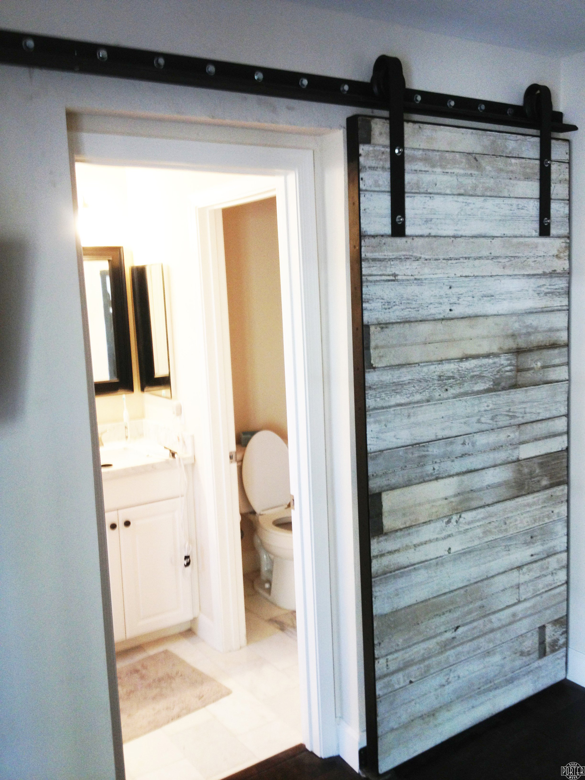 Sliding barn door for home bathroom