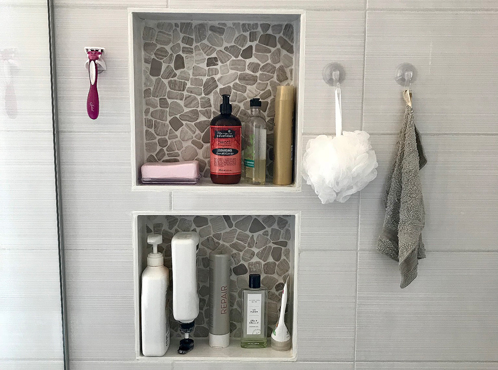 Two built-in shelves in a shower