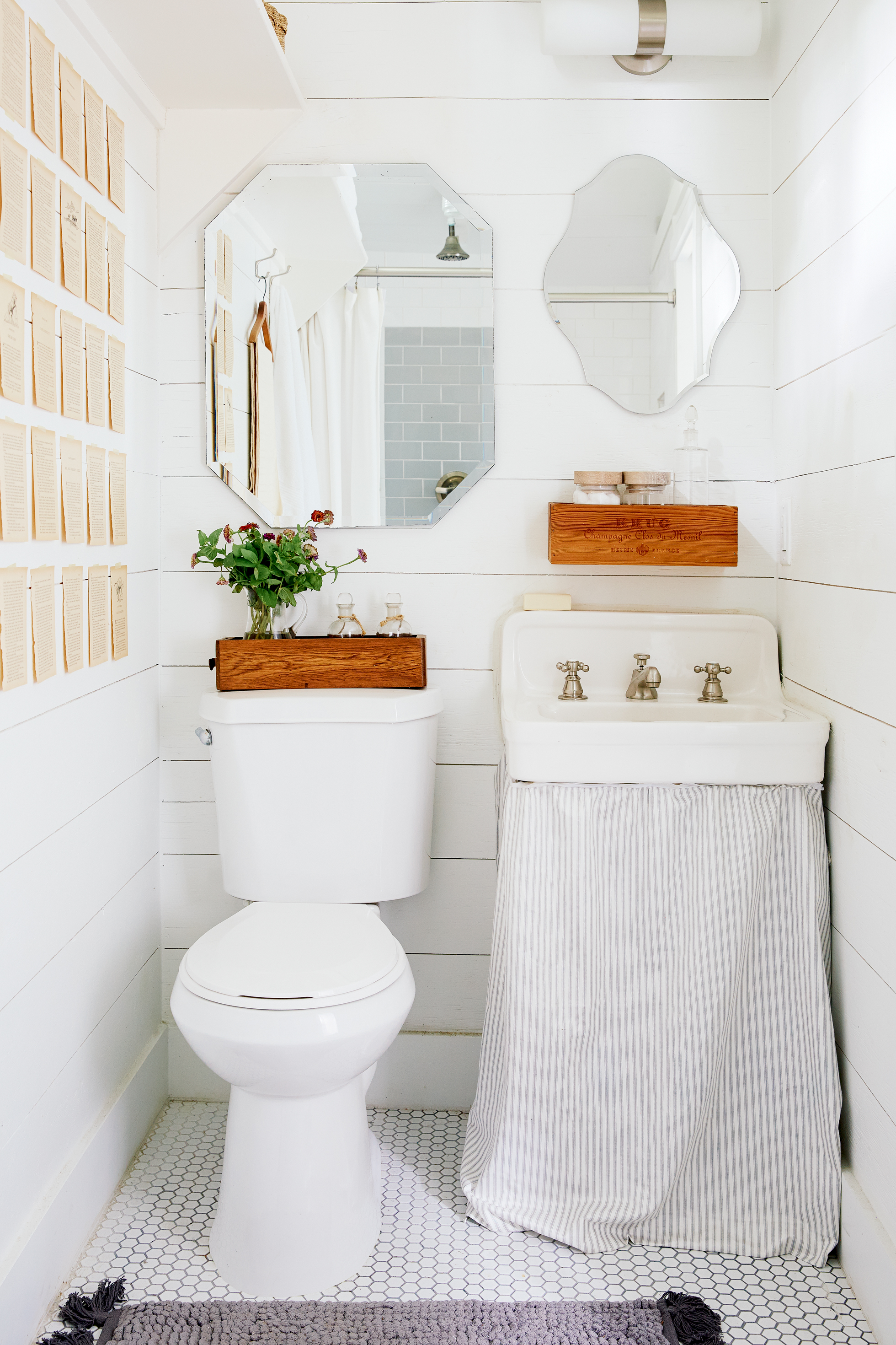 A cream-colored bathroom with a pedestal sink