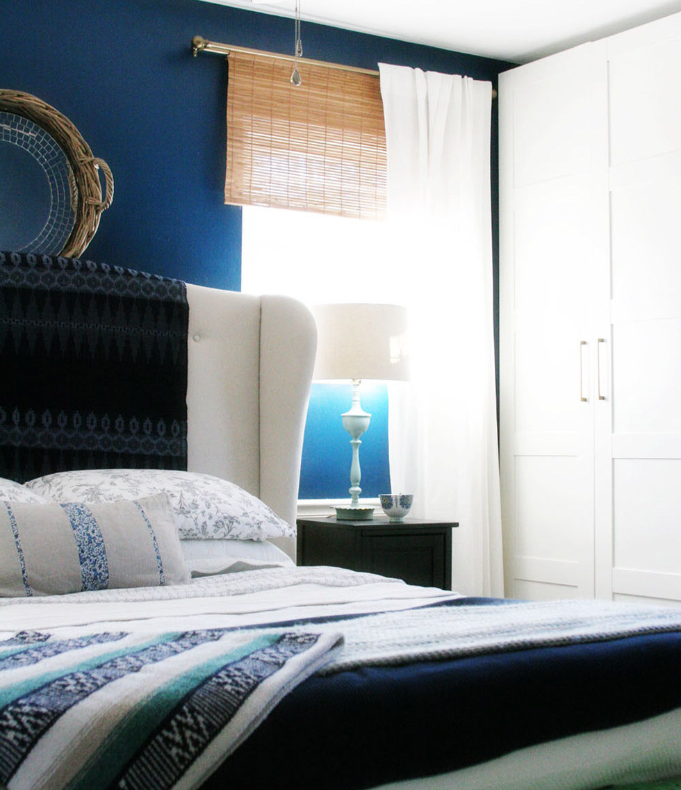 Blue bedroom with white accents and white curtain