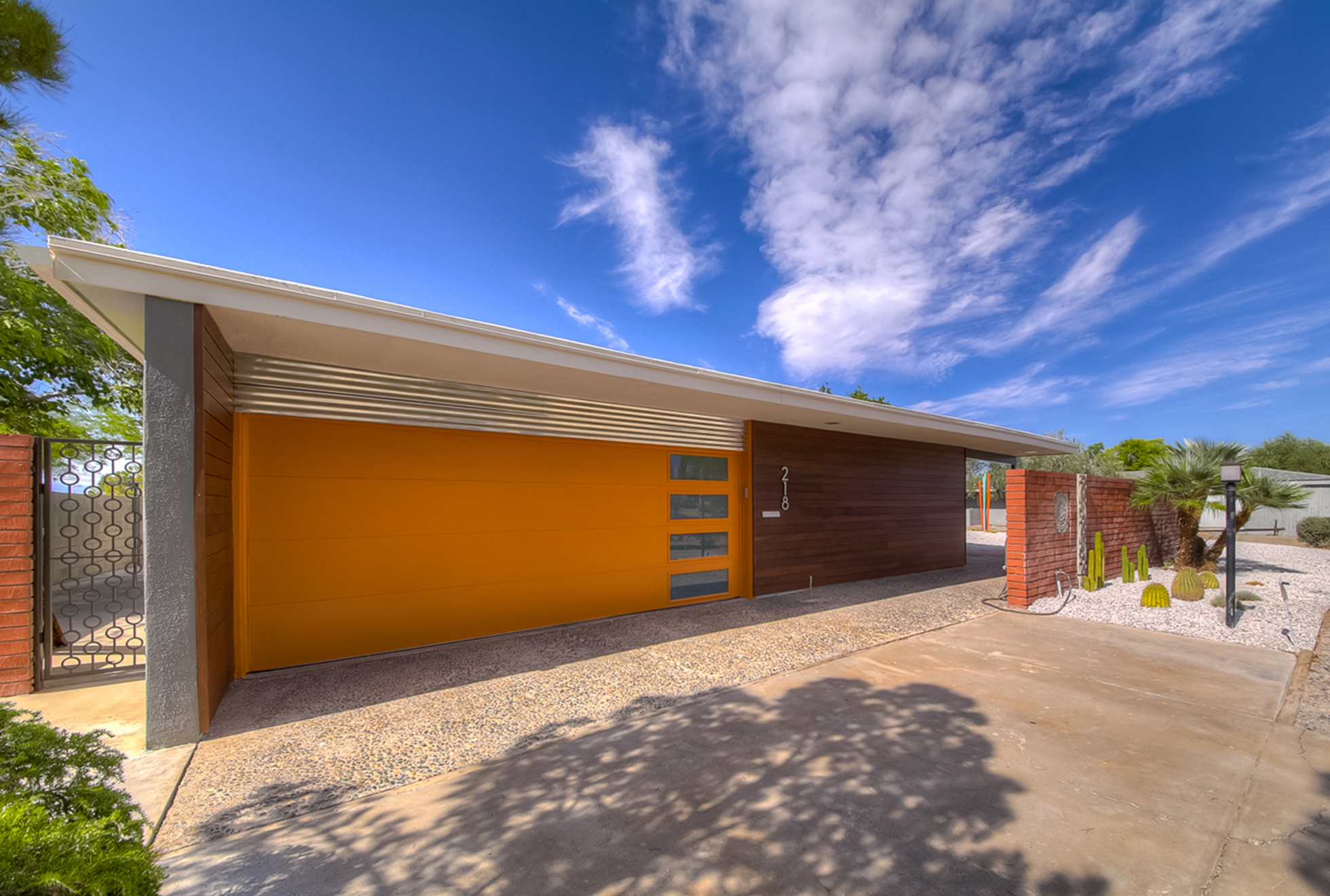 Orange garage door on mid-century modern California home