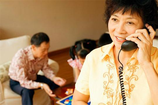 Woman reviewing house offer over the phone