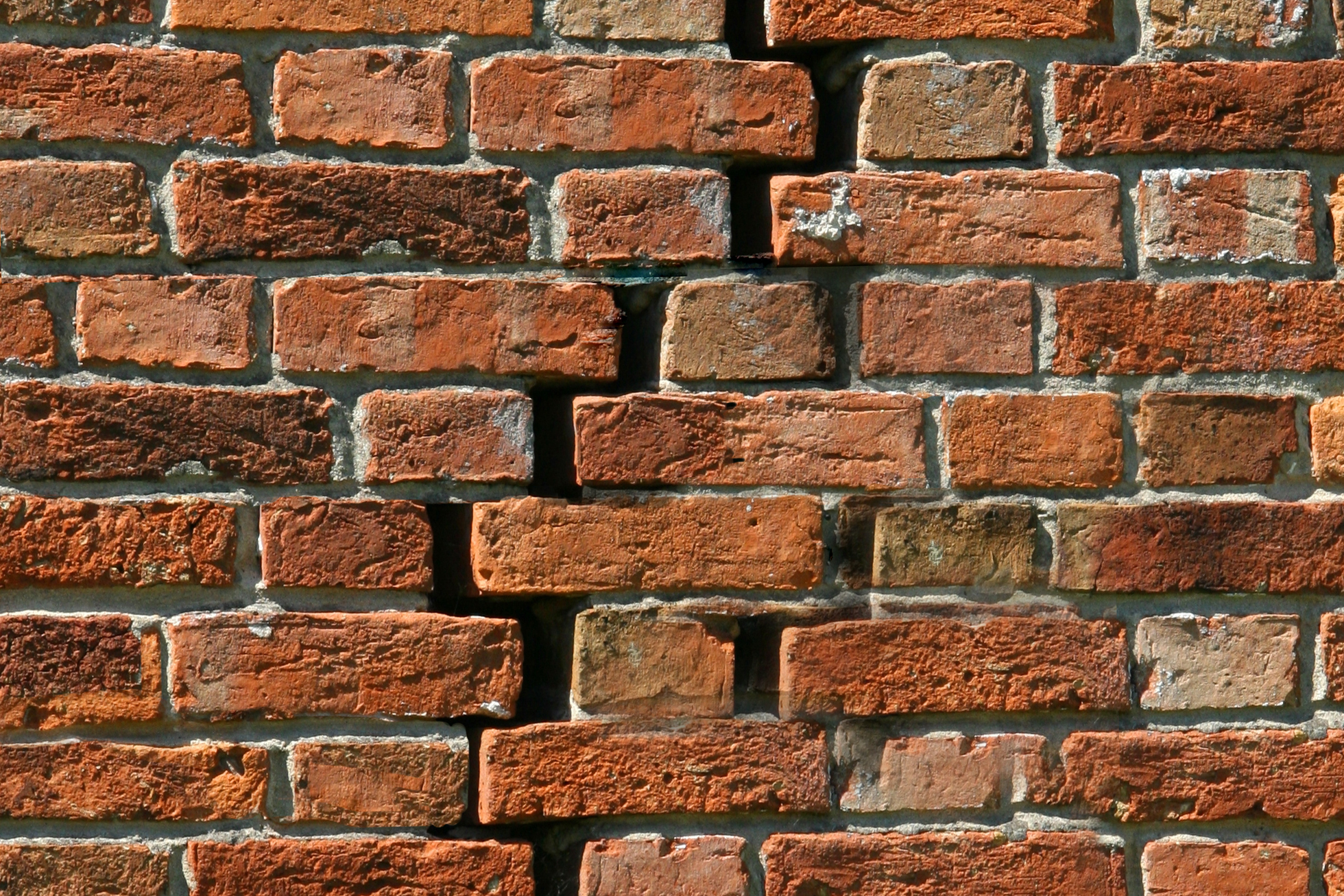 Brick exterior wall with damage