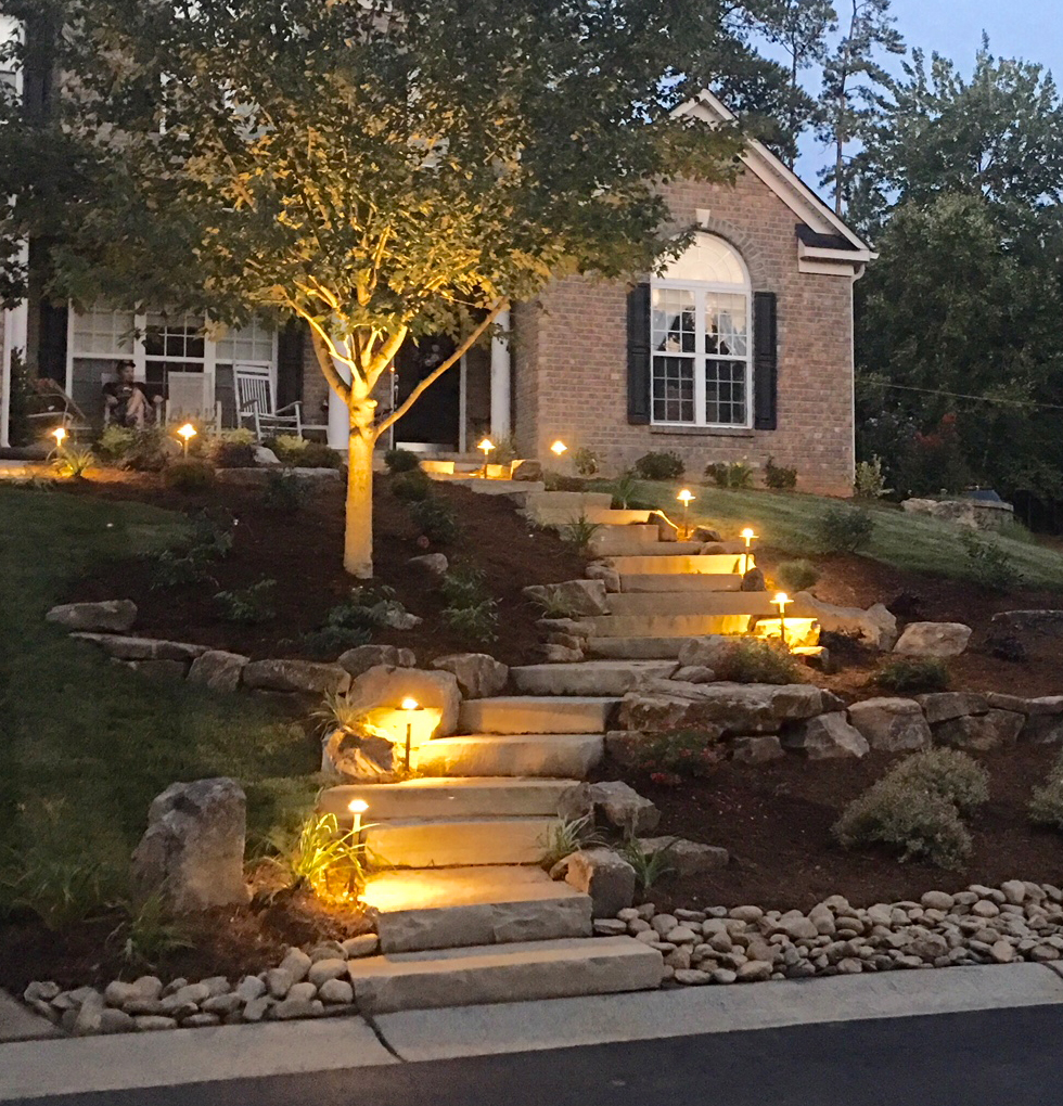Outdoor stone steps lit with pathway lighting