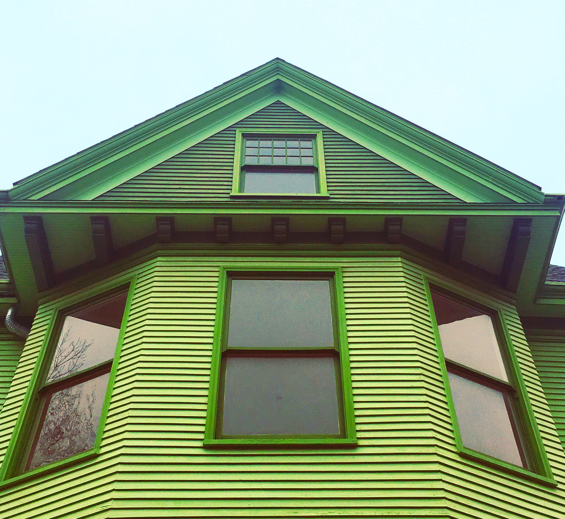 Home with bright green painted siding