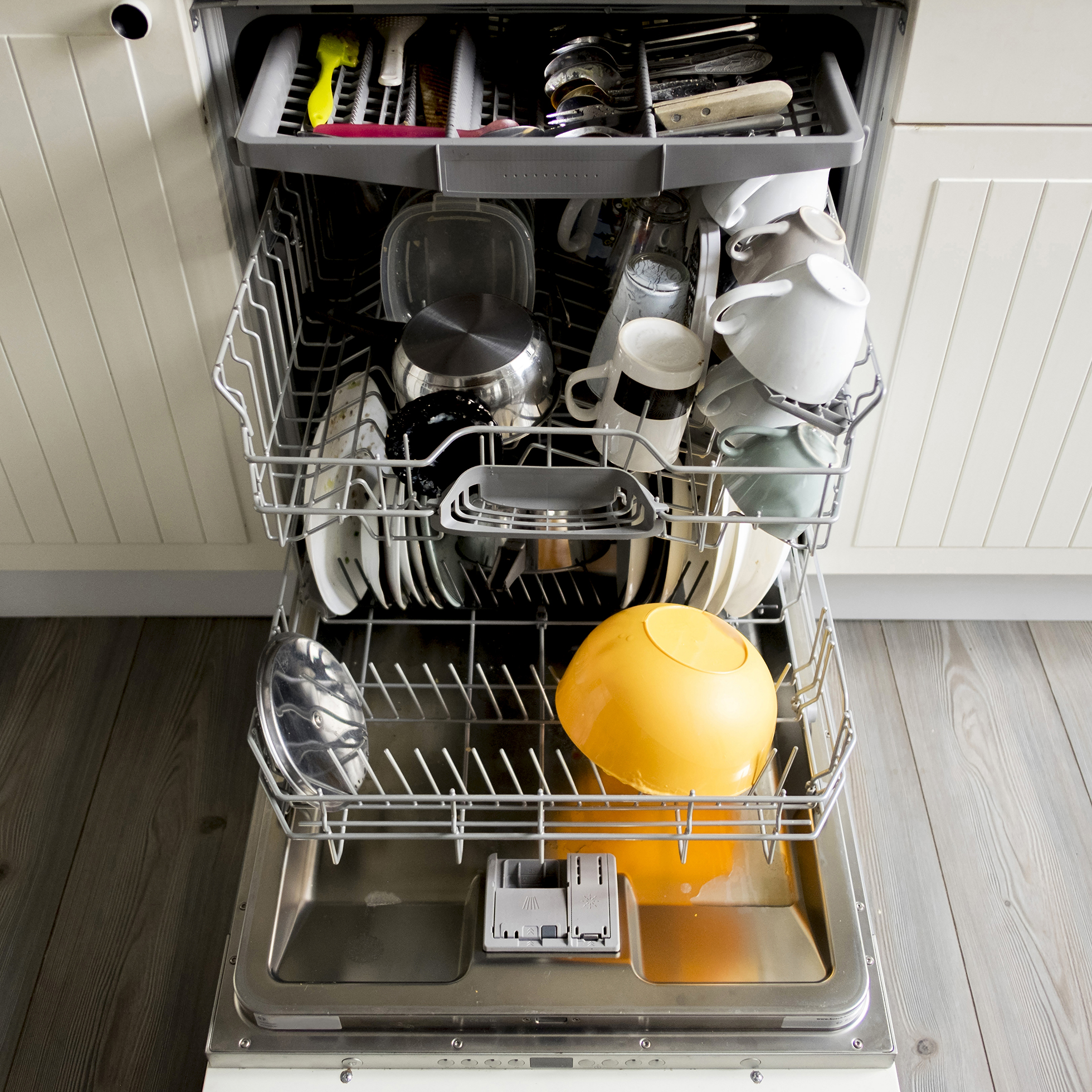 High angle view of dishes and utensils in dishwasher