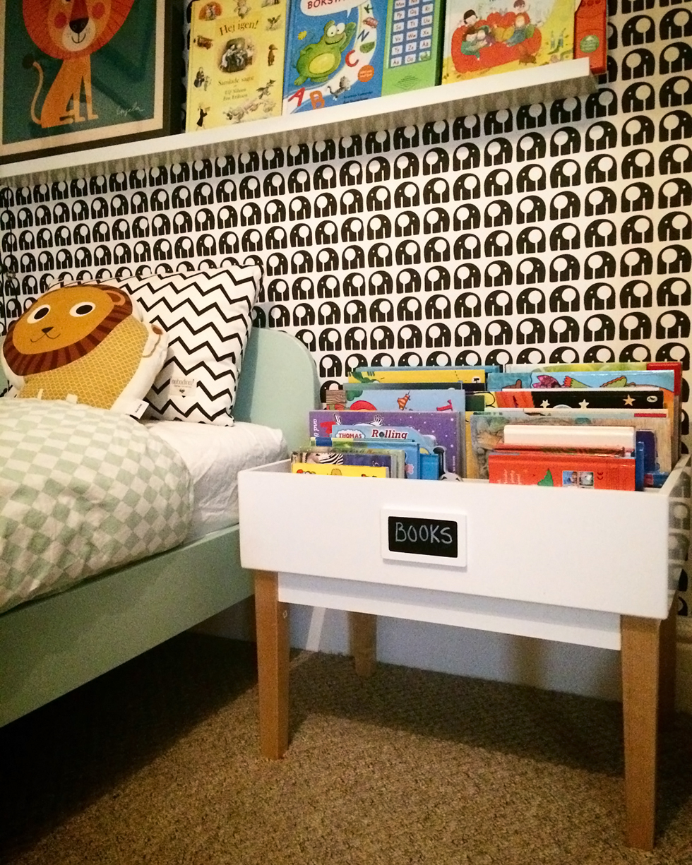 Record organizer used for kids' books in very designed room