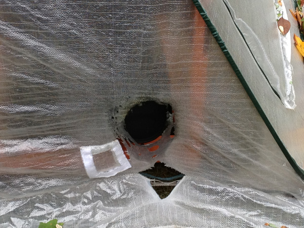 Hole melted in structure used over portable generator