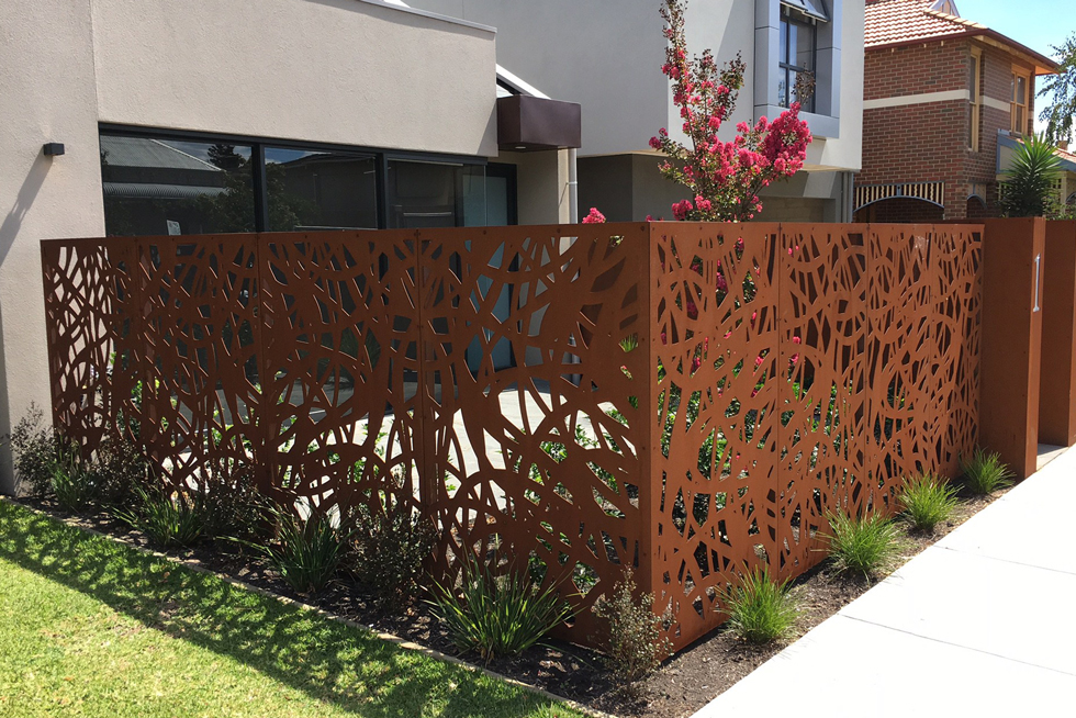A patterned Corten steel backyard fence