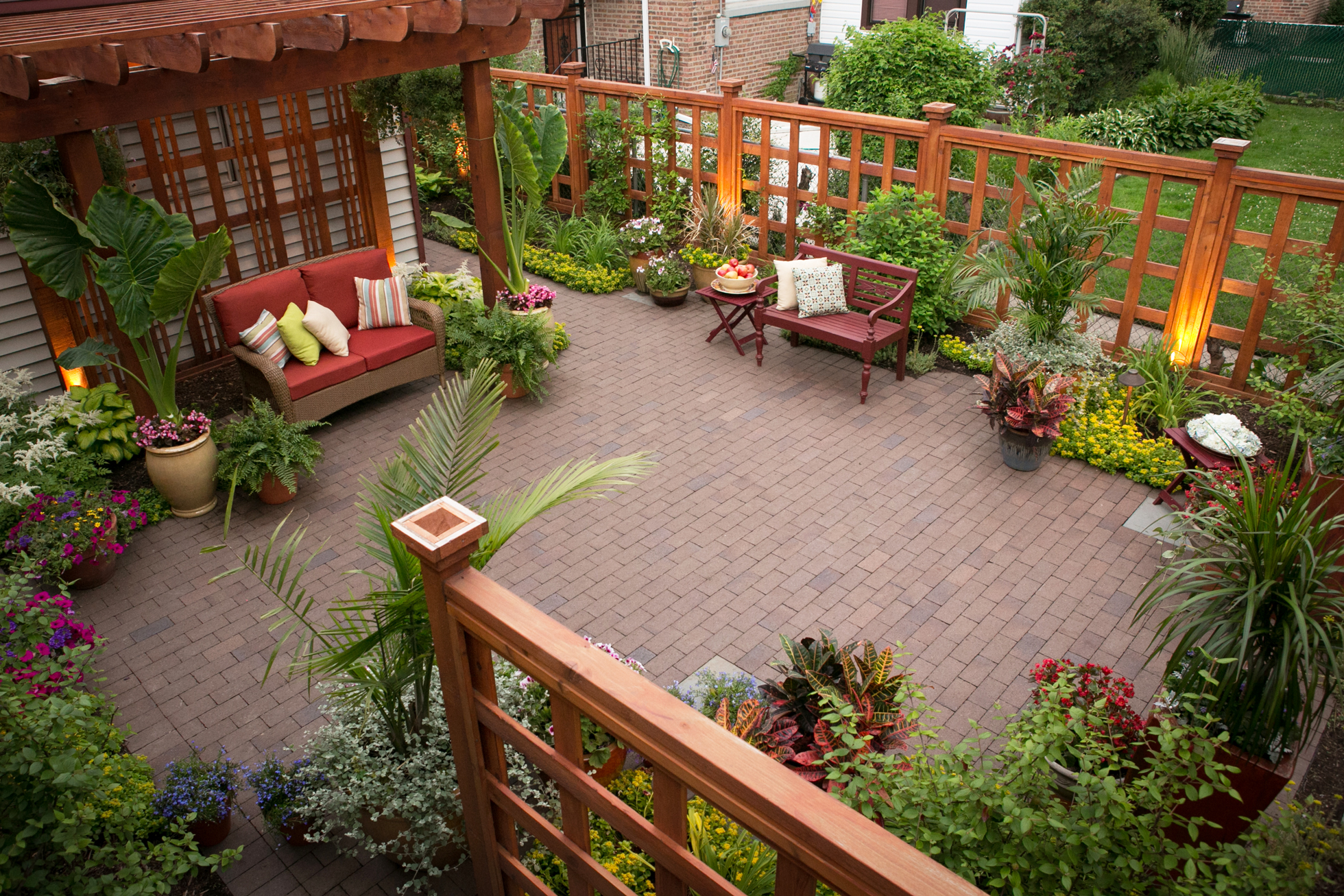 A backyard pergola and wood fence