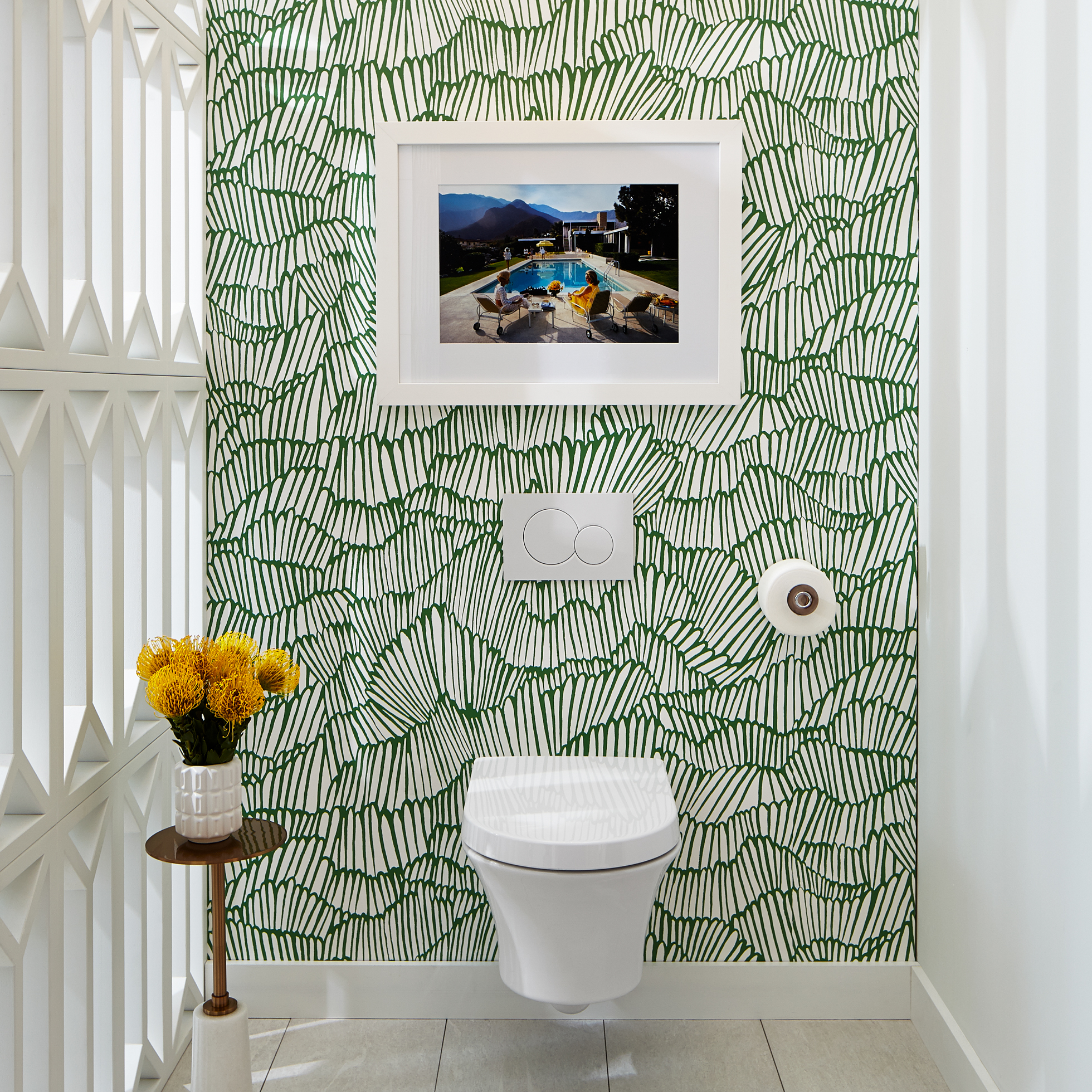 Bathroom with white/green wallpaper and wall-hung toilet