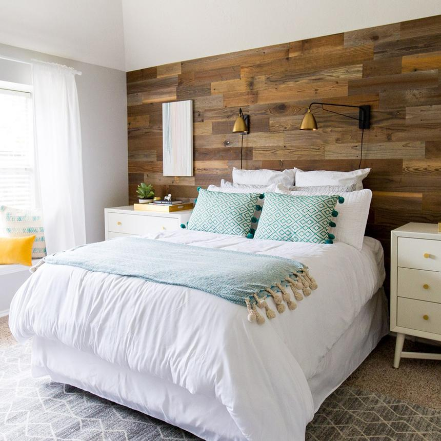 An after image a of a bright bedroom with DIY wood panel