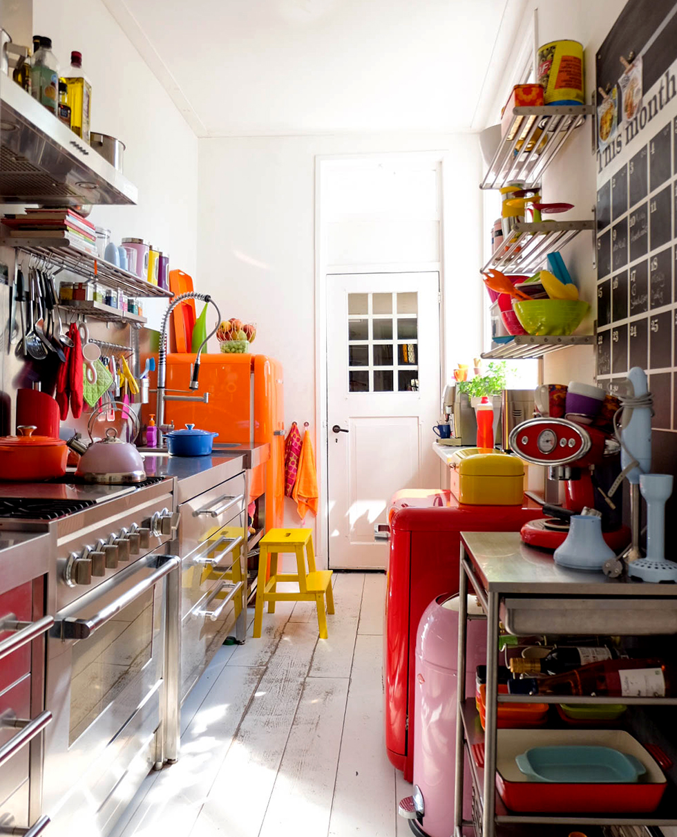 Organized kitchen stocked with brightly colored dishes