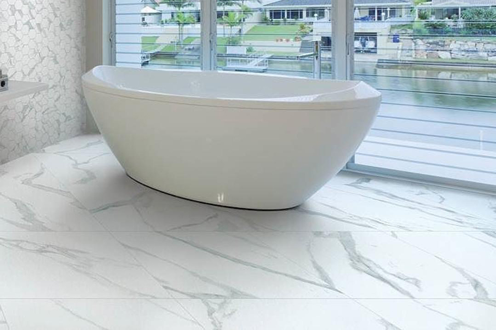A white bathroom with tub and porcelain tiles