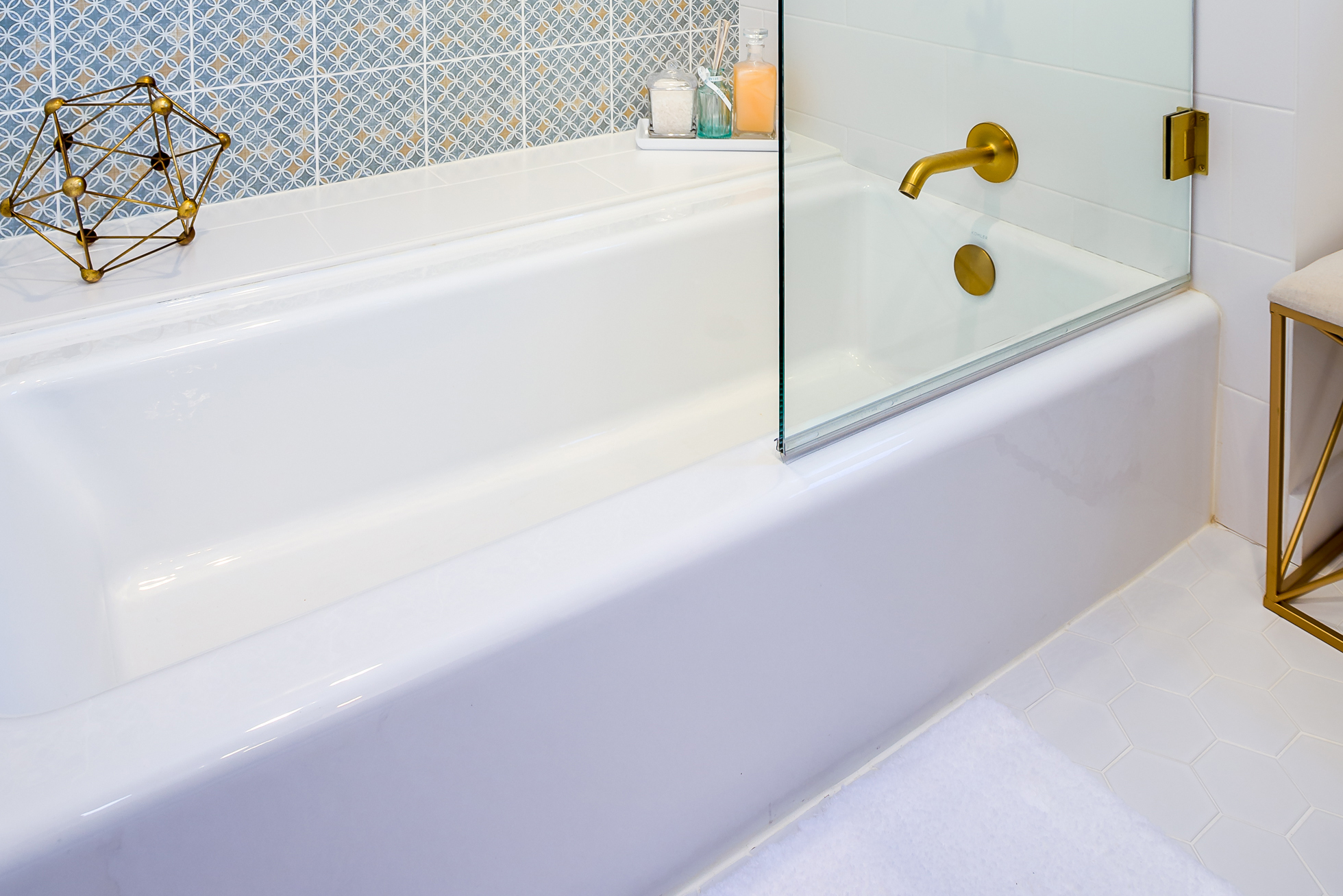 A white porcelain tub in a bathroom