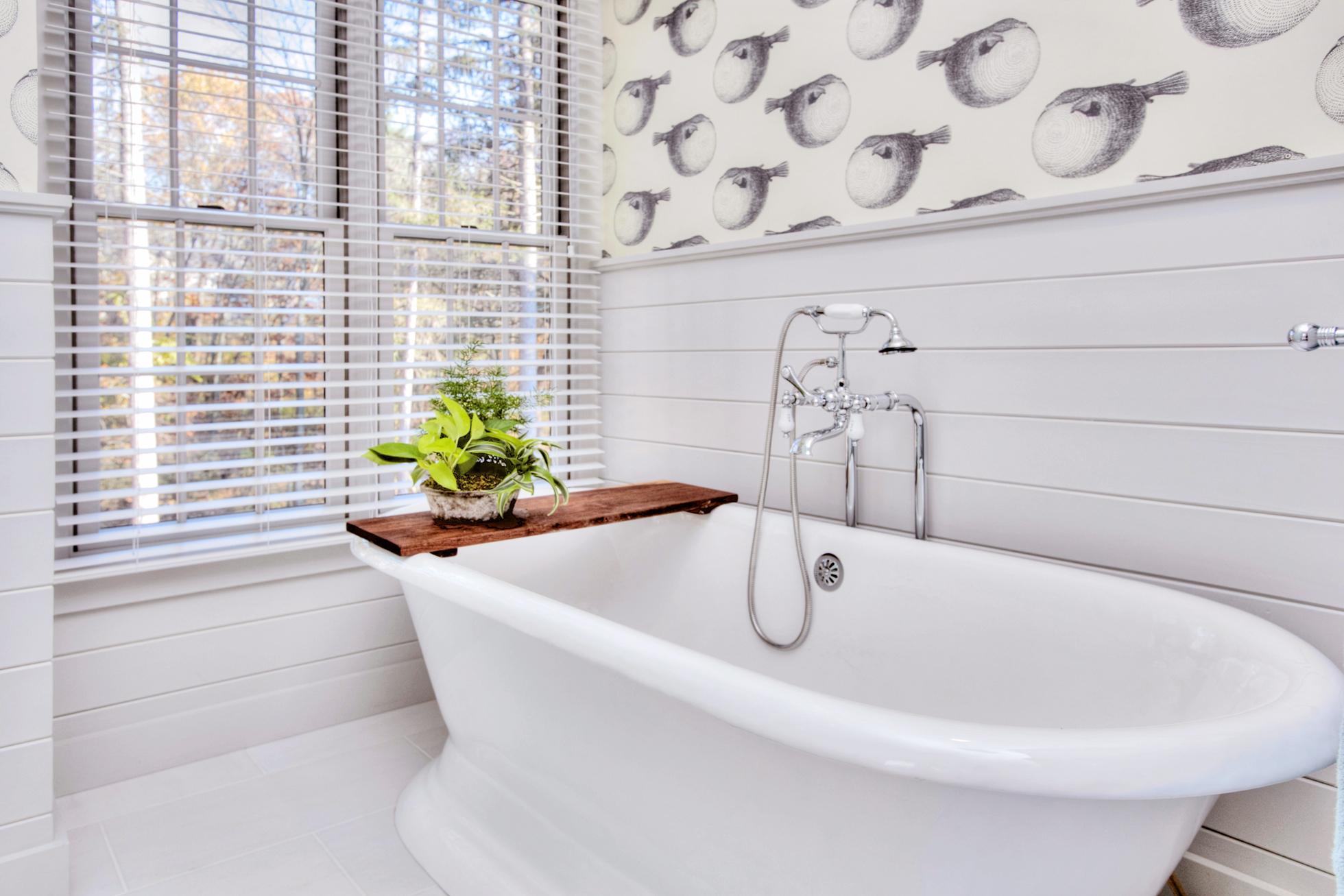 A white cast iron tub in a white bathroom