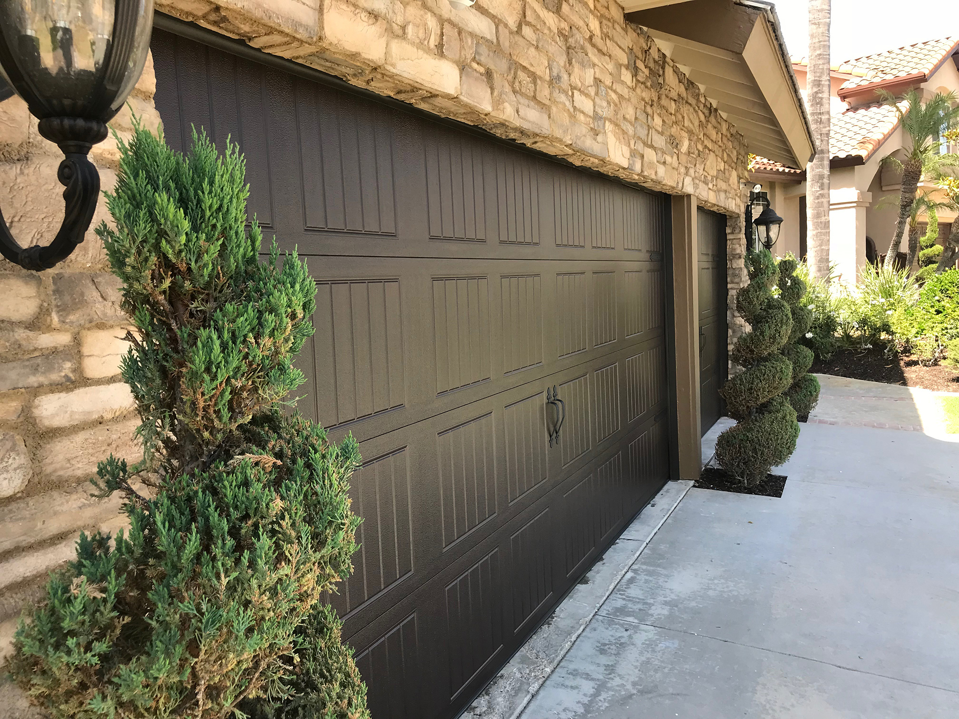 Dark brown carriage garage doors made of steel