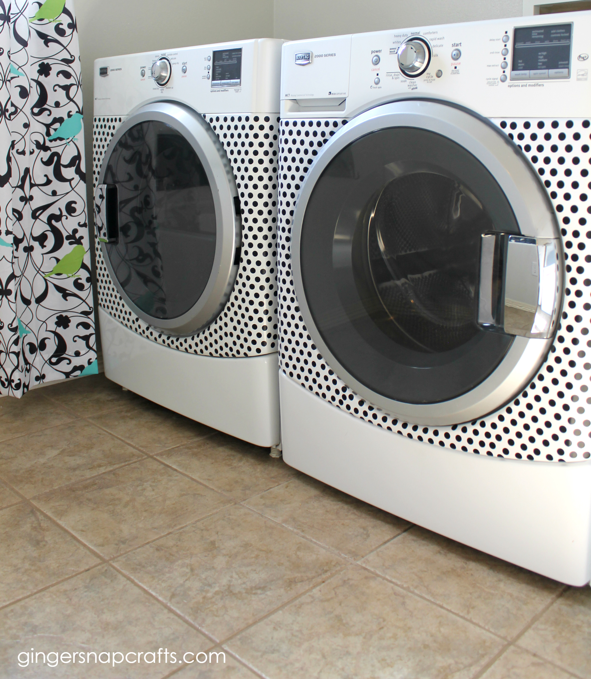 White washing machine and dryer with black polka dots