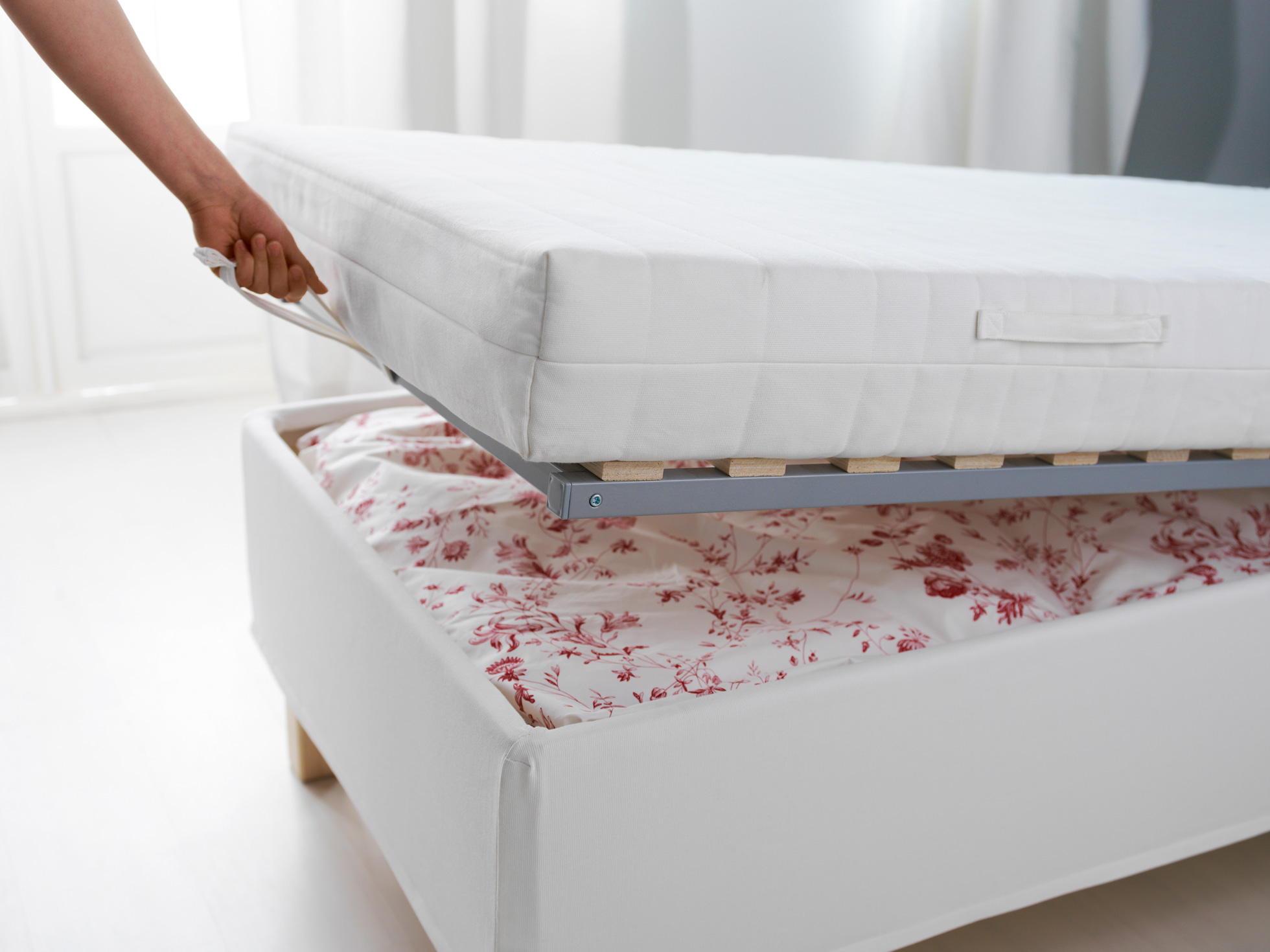 A bedframe with a hidden storage compartment