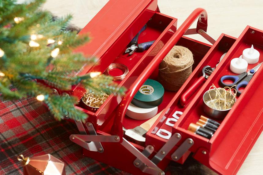 A red toolbox with holiday-related items