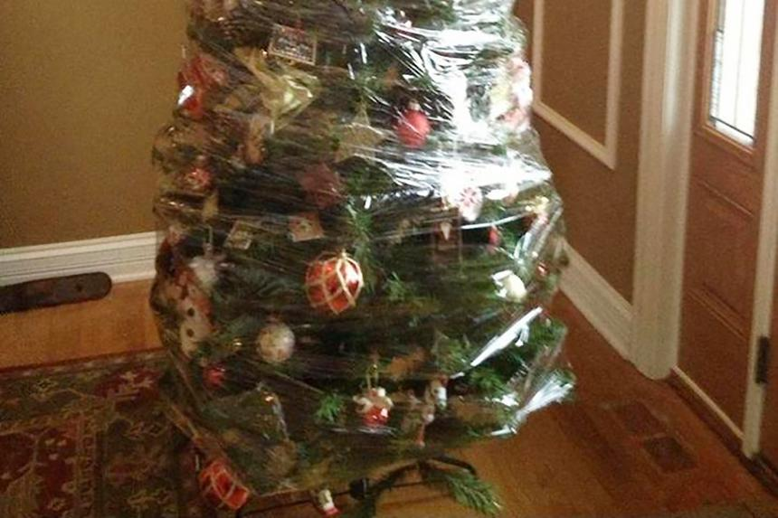 A fake Xmas tree with decorations wrapped in shrink wra