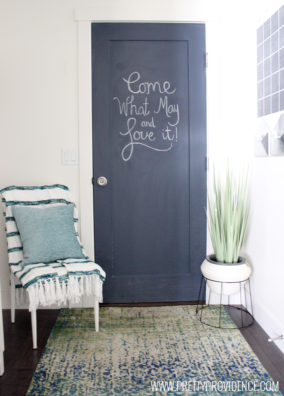 "Chalk door that says, ""Come what may and love it!"""