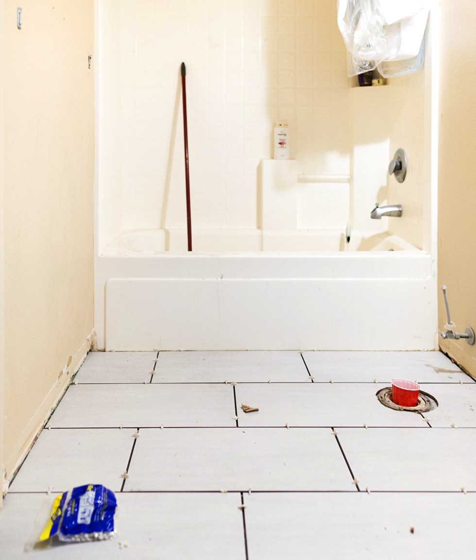 Freshly laid white tile as part of a bathroom renovation