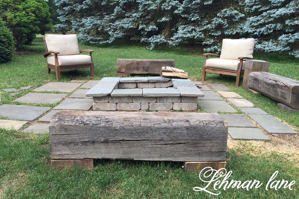 A gray paver patio with fire pit