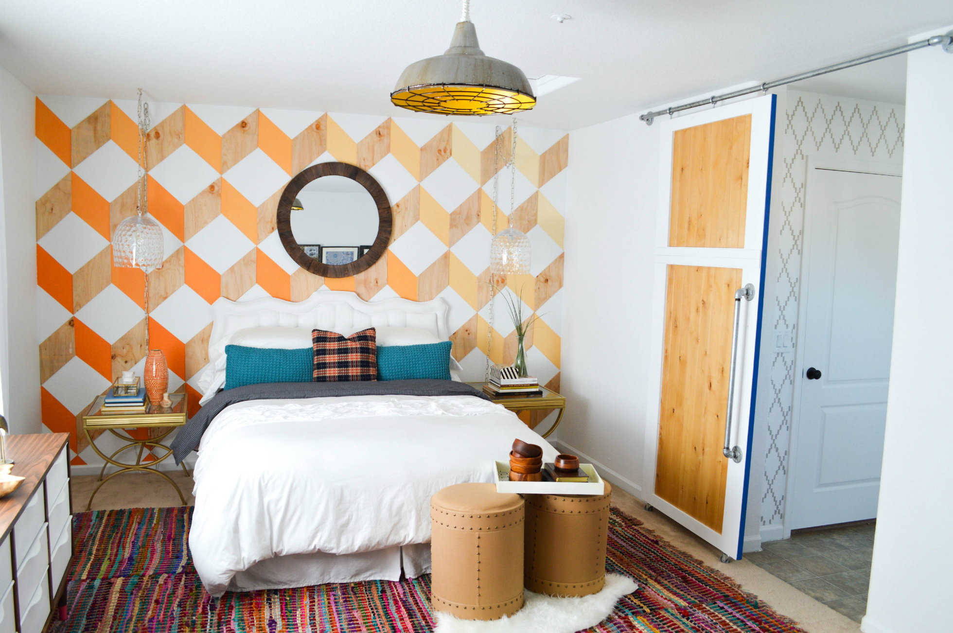 Remodeled bathroom with orange patterned walls