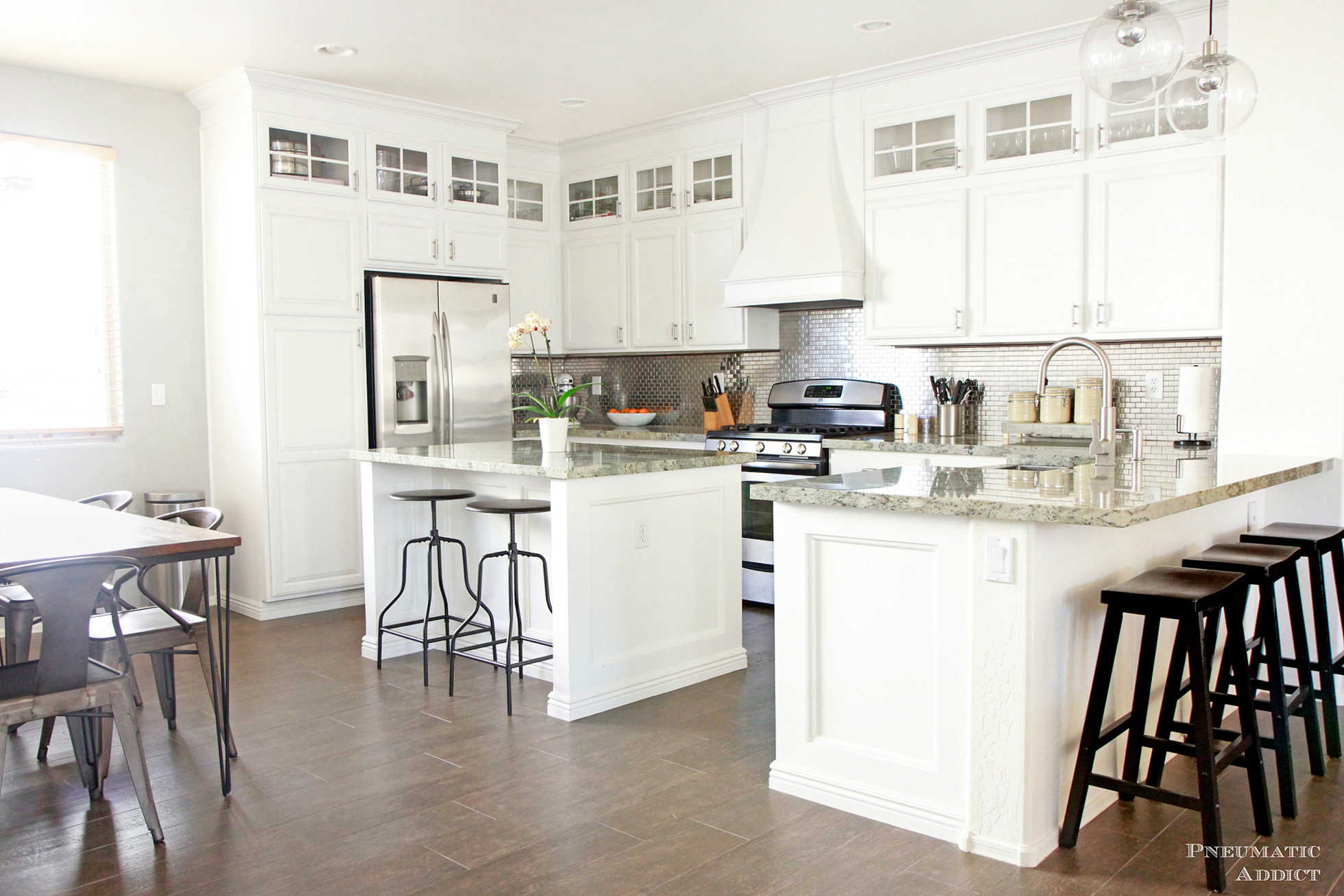 Bright white cabinets and a dark wood floor
