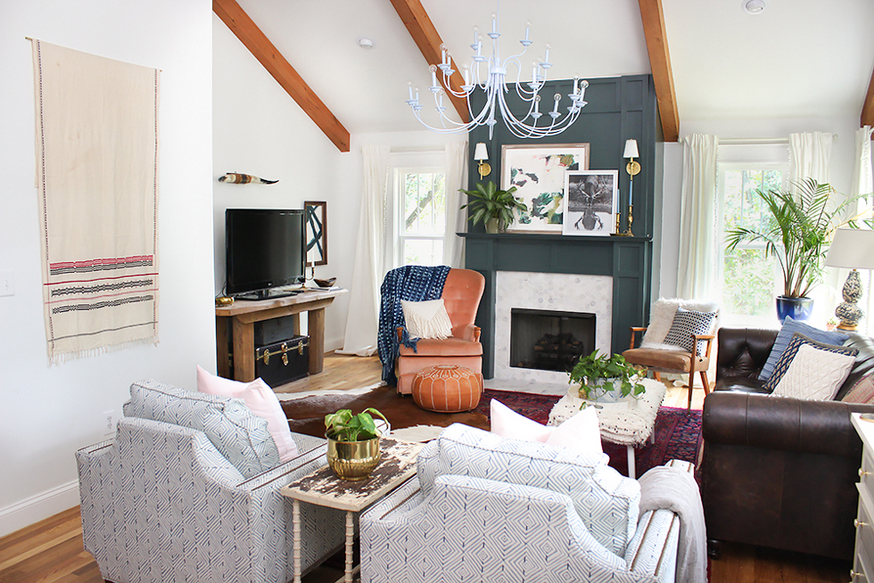 White painted living room with exposed wood beams