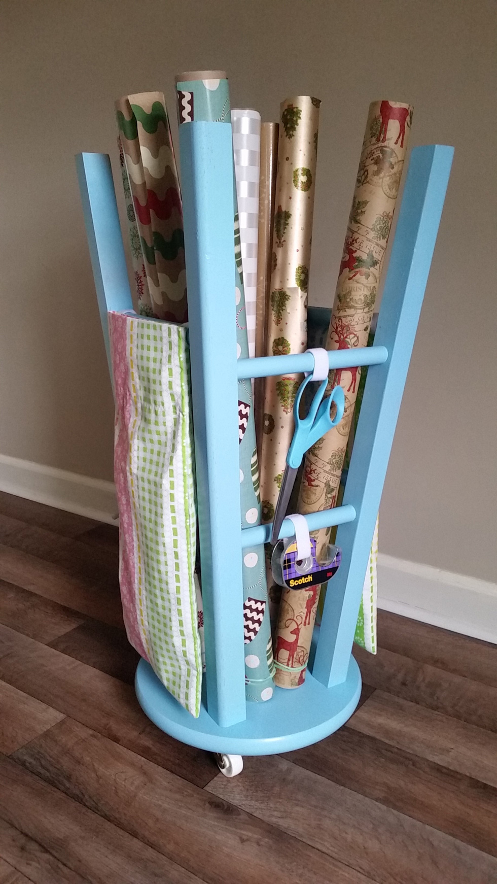 Gift wrap organizer created from a wooden stool