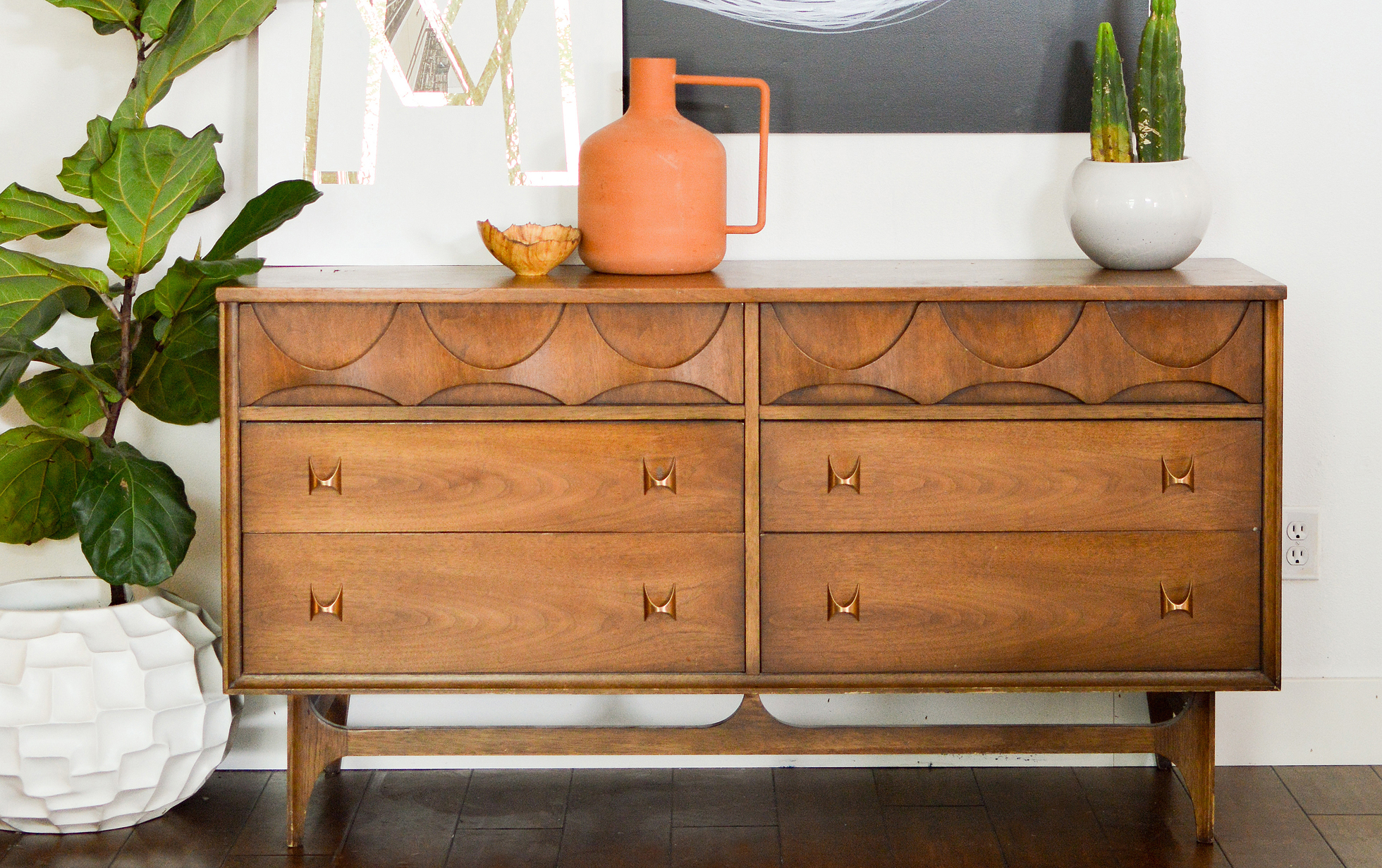 A refinished wood dresser in a bright living room