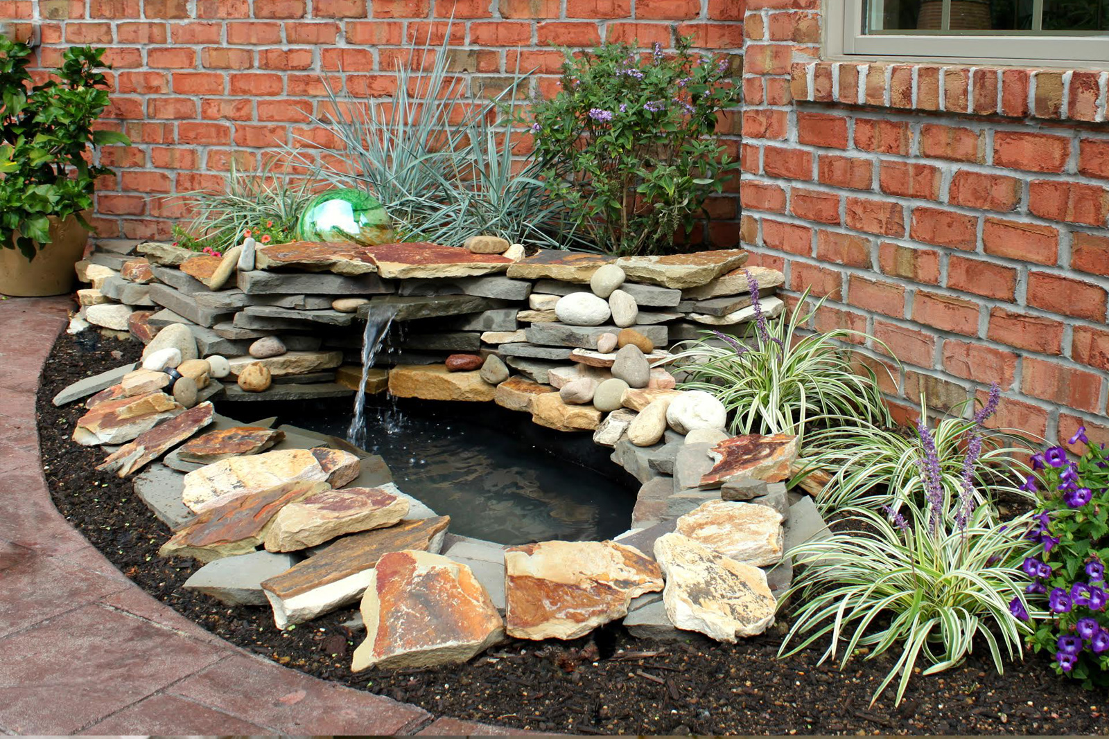 DIY waterfall and pond water feature in yard