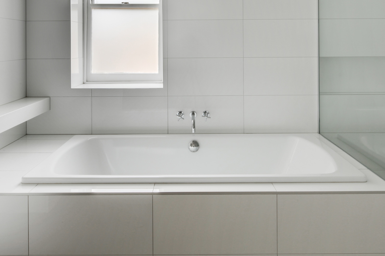 Superieur A Stark, White Tile Bathroom With A Tub And Window