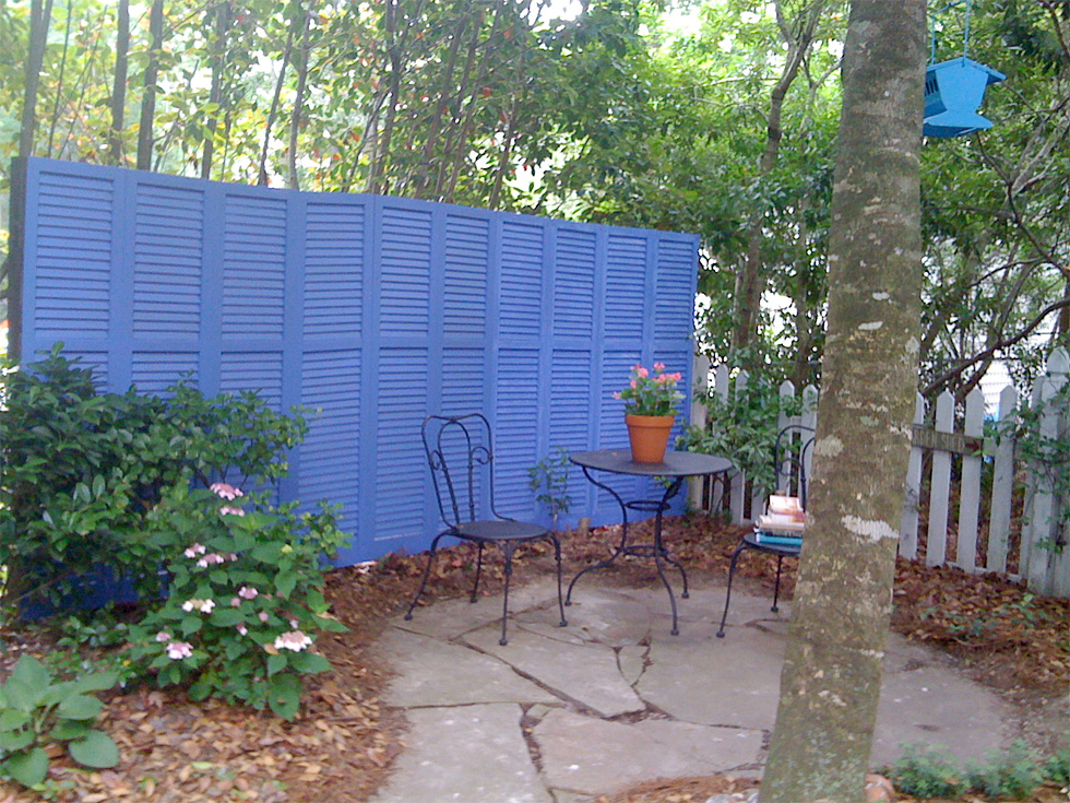 Blue shutter as fence in outdoor space