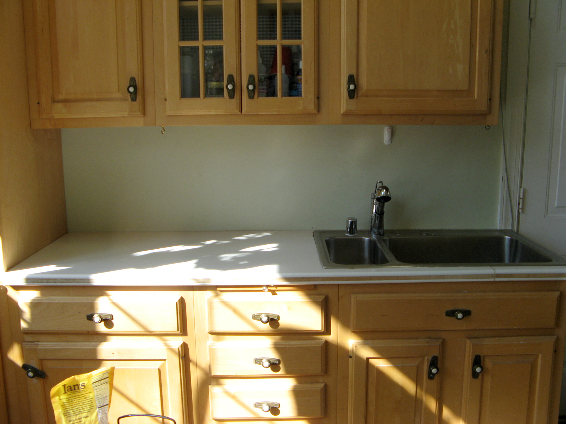 Blond cabinets with faucet | Faux Granite Countertops
