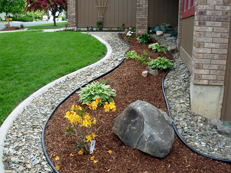Front yard landscaping using rocks and mulch