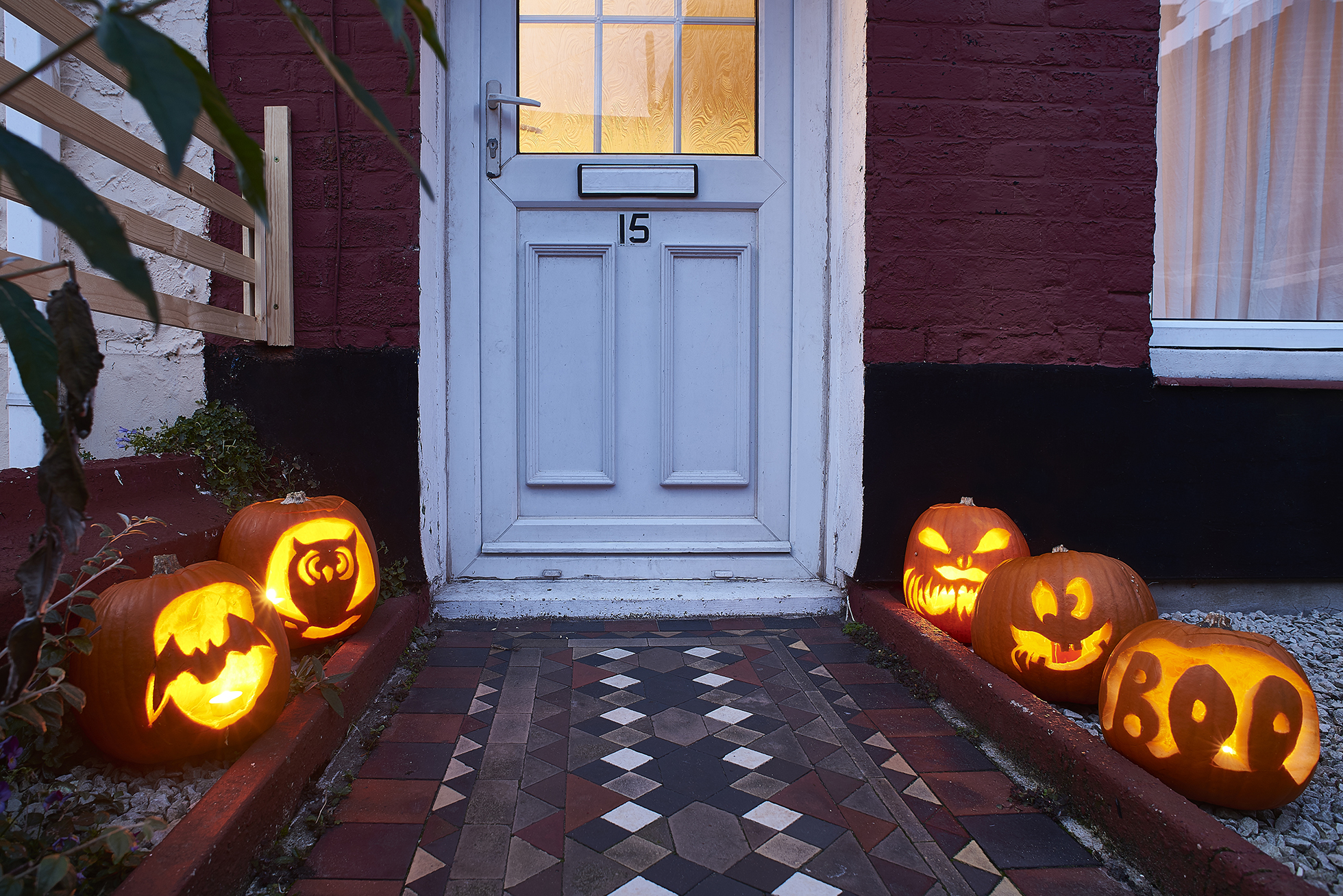 Brick path lined with jack-o-lanterns lit with LED candles