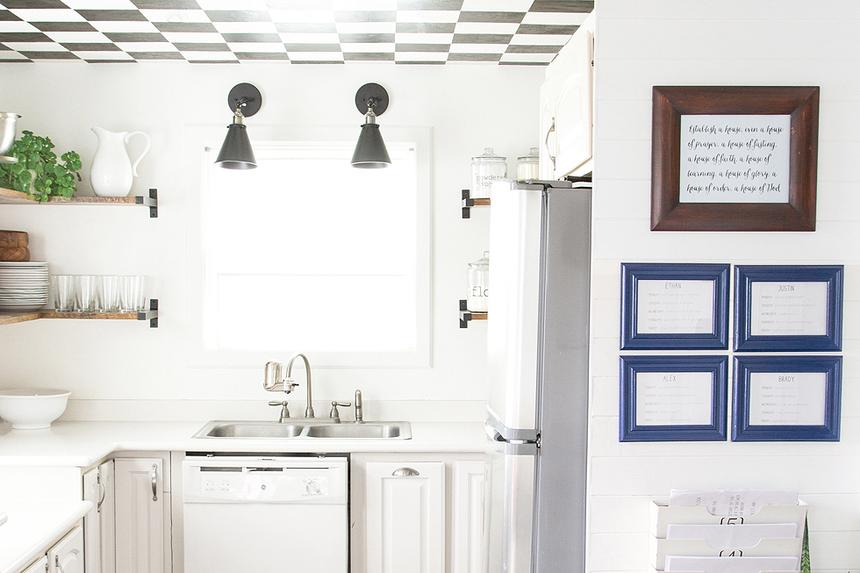 White kitchen with wood floors, white and black ceiling