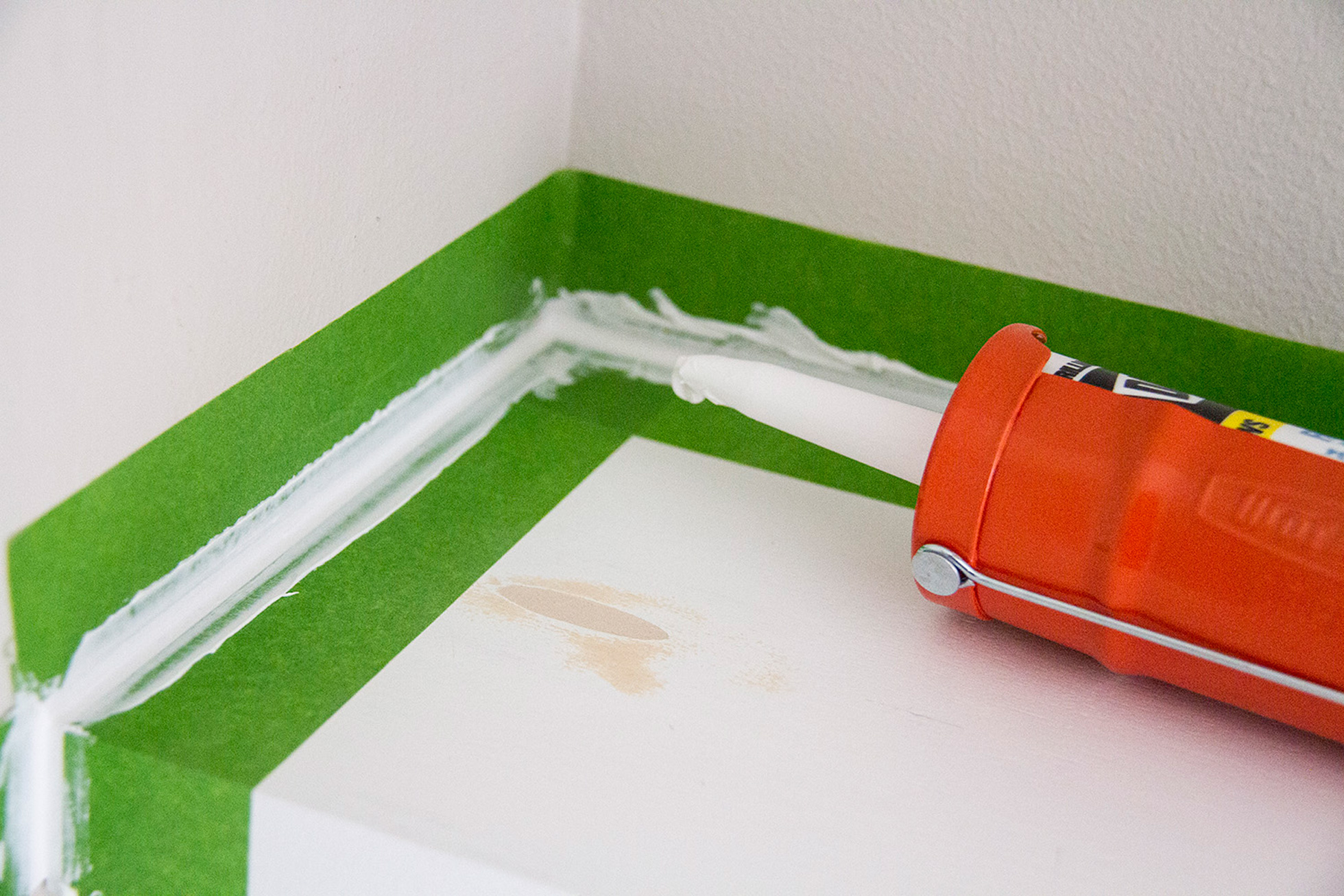 Use painters tape when caulking for straight lines
