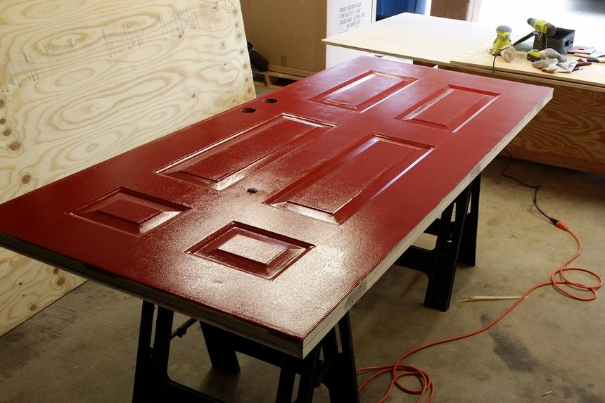 Red door on sawhorses