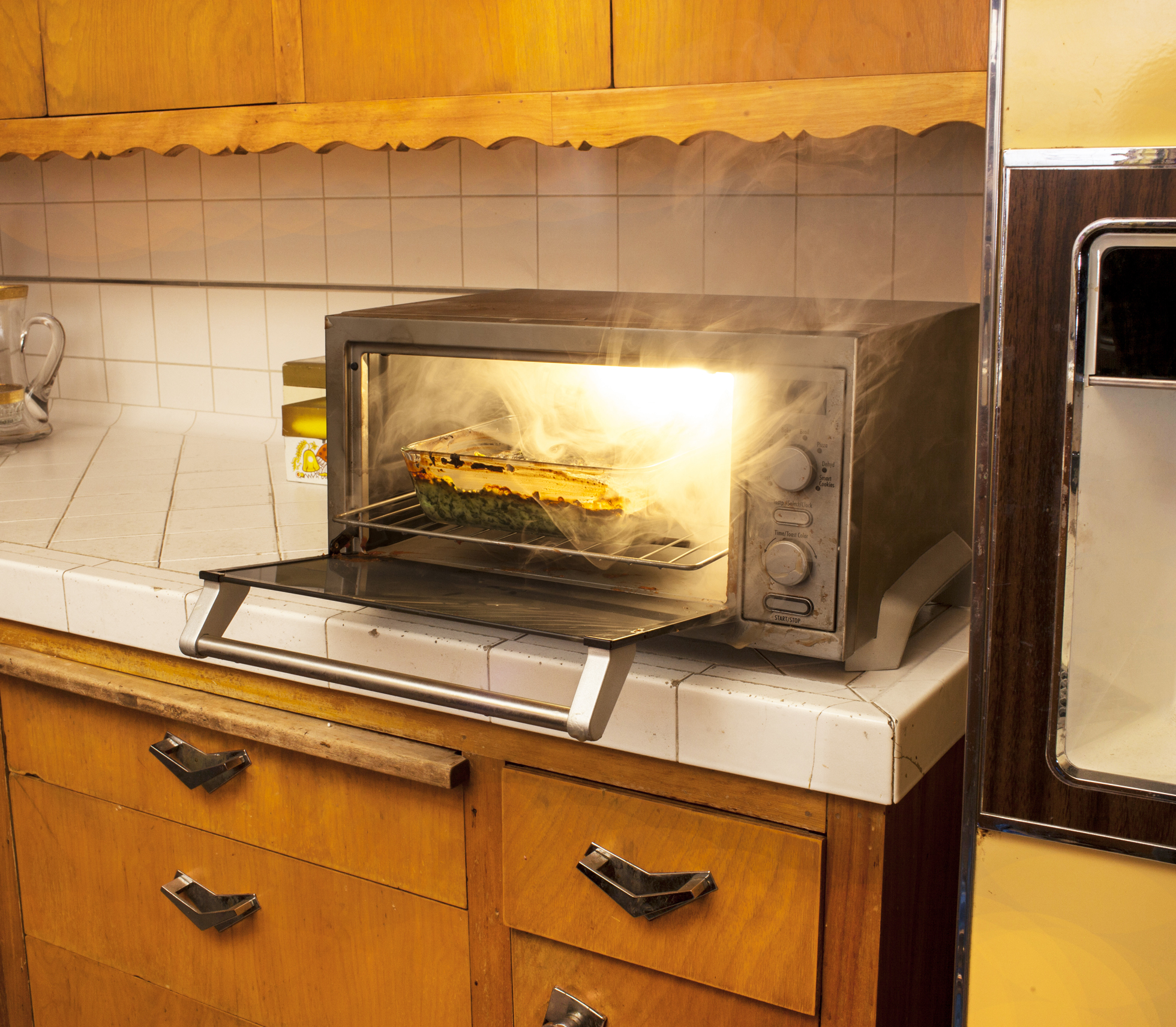 Toaster in home kitchen on fire