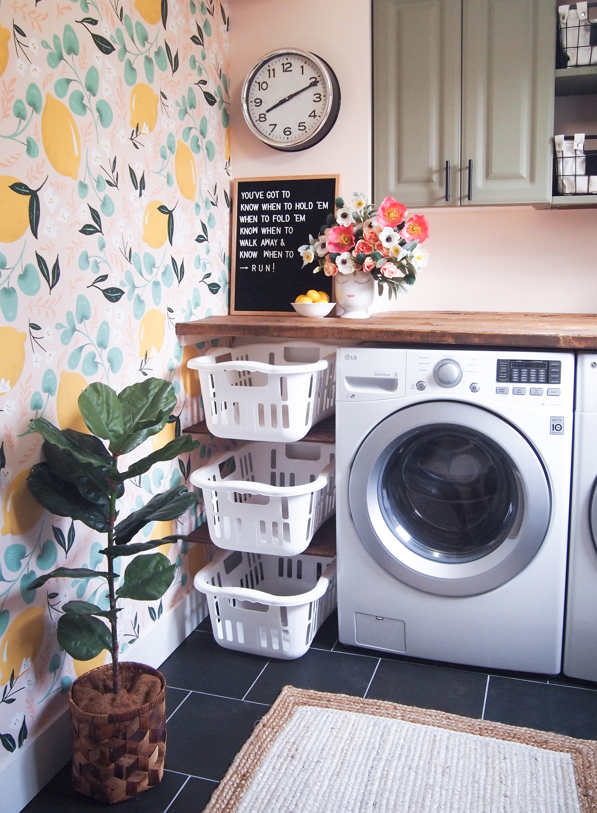 Sunny laundry room with counter above washer and dryer