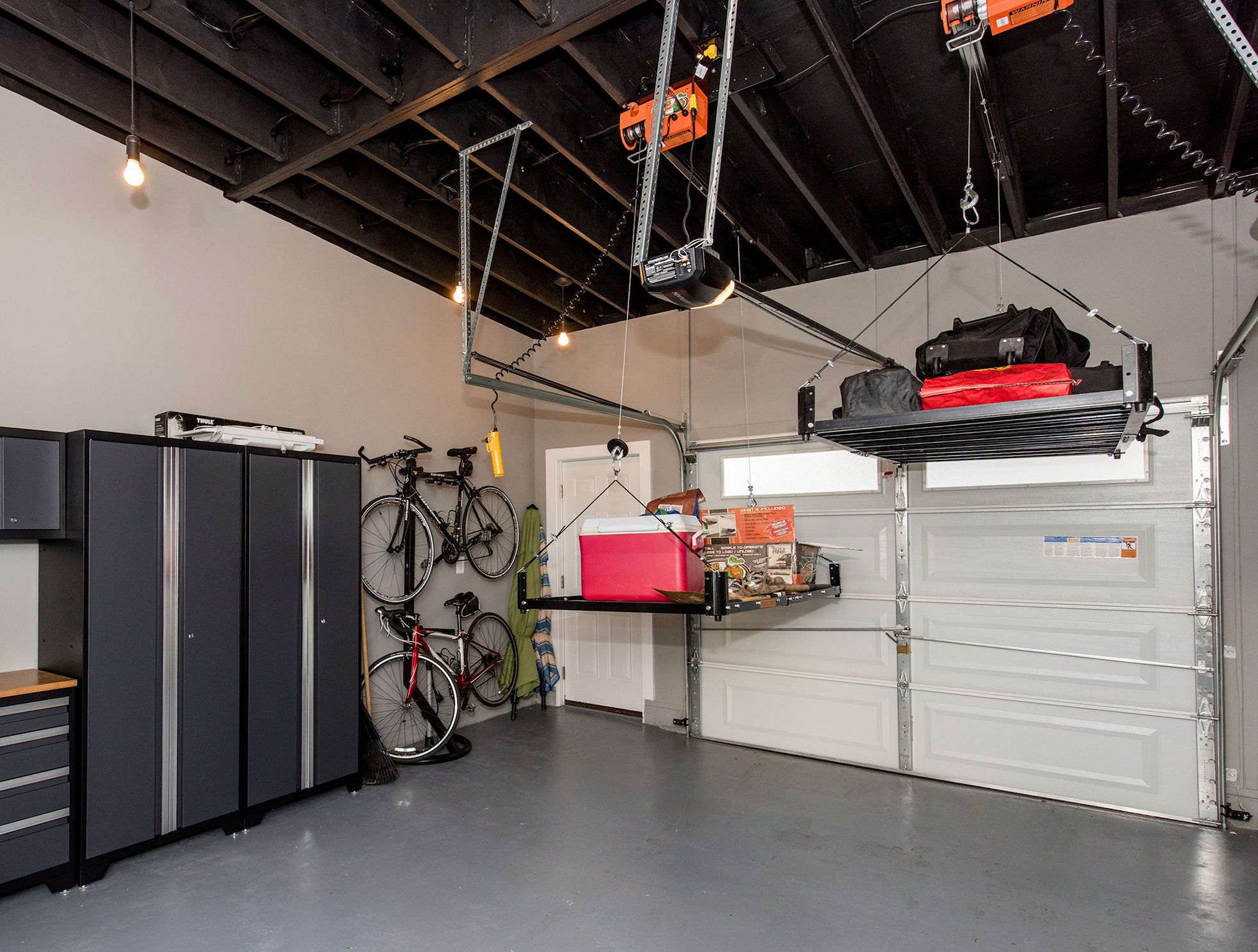 A garage outfitted with a pulley storage system