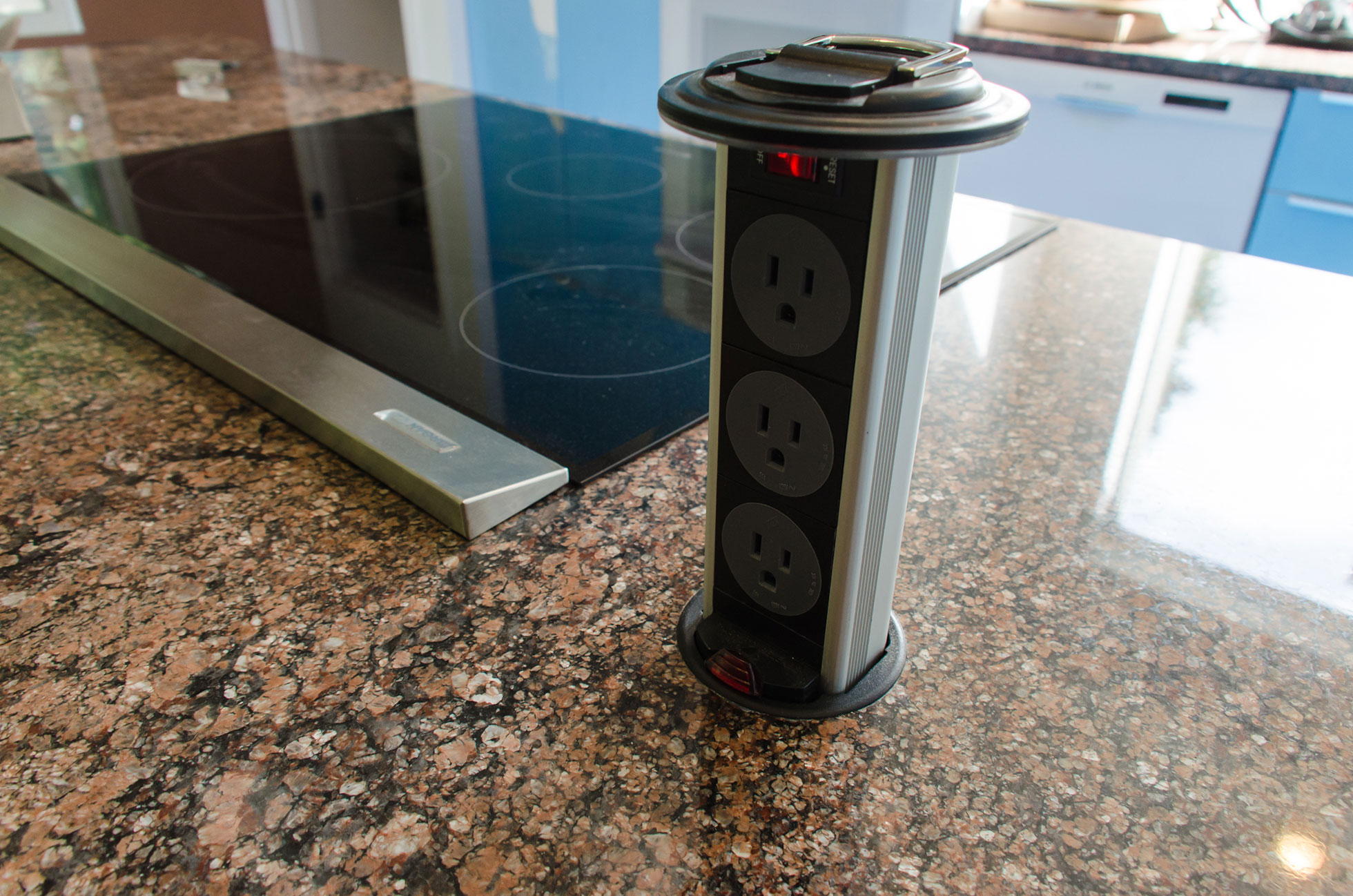 Kitchen island with pop-up power outlets