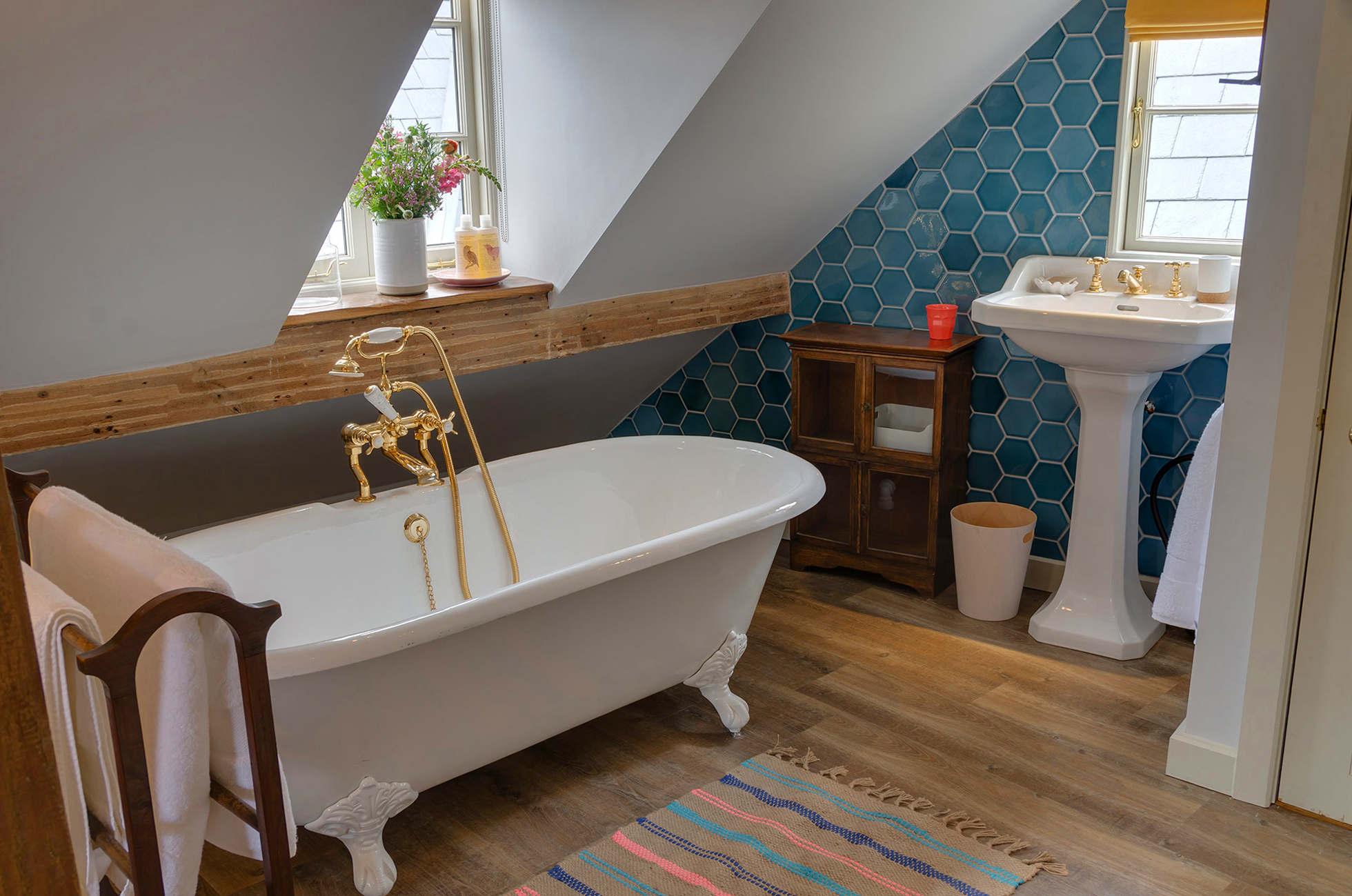 Renovated attic bathroom with hex tile wall